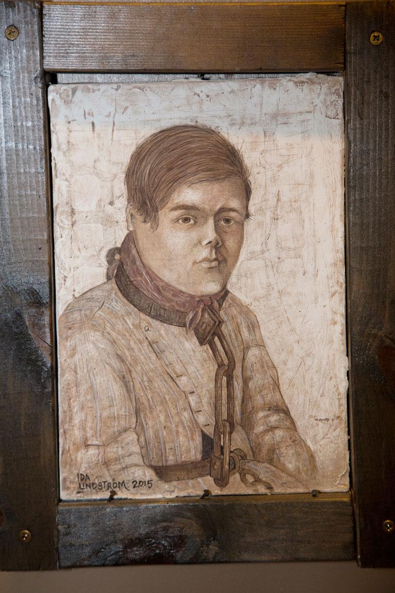 Juhani Aataminpoika kahliittiin sellinsä seinään vuonna 1853.