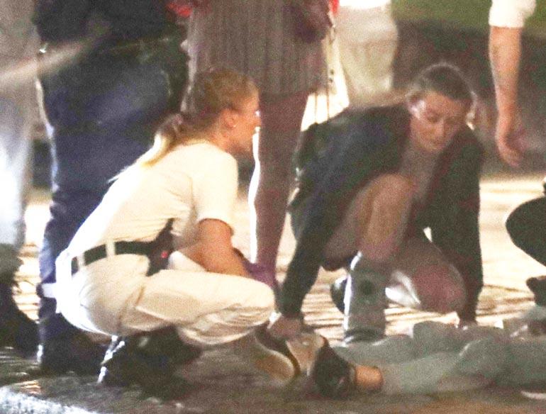 Seurapiirikaunotar Karina Kivilahti oli ensimmäisenä auttamassa maahan lyyhistynyttä miestä, vaikka hänen oma jalkansa on paketissa.