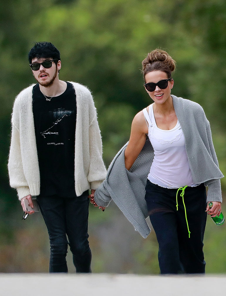 T on April 14, 2020** Kate Beckinsale walks hand in hand with 22 year old boyfriend, Goody Grace! The 46 year old actress was seen taking a break from quarantine Sunday afternoon with the young musician. Kate was first spotted with with Goody Grace back in January as the two were seen leaving a party together.