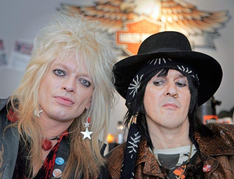 Michaelilla ja Andyllä on pitkä yhteinen historia. Rokkikukkojen viilenneet välit ovat nyt lämpeämässä. Kuva on vuodelta 2008.