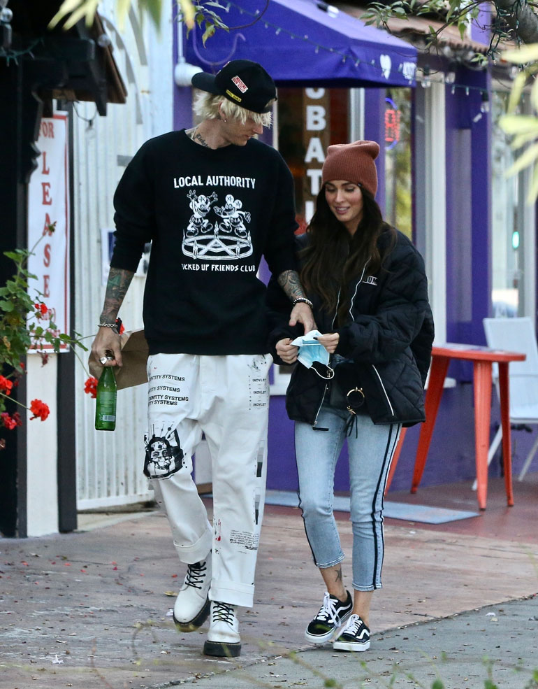 Happy couple Megan Fox and Machine Gun Kelly pick up food and drinks to go while out enjoying a day together.