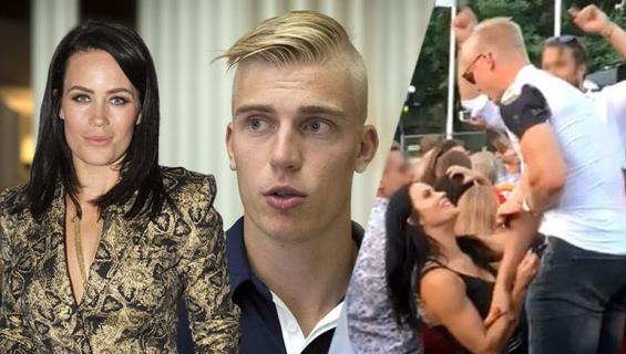 Martina Aitolehti repi Rasmus Ristolaisen paidan napit.