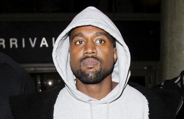 Kanye West paparazzattiin