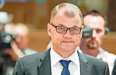 Juha Sipilä yllätti Hesburgerissa.