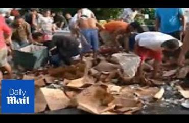 Konjakkikuorma kaatui Filippiineillä - paikalliset hamstrasivat kilpaa ilmaista viinaa! Katso video!